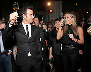 Justin Theroux and Jennifer Aniston toast with Paradis Imperial at the Hennessy Paradis Imperial Reception at the Santa Barbara International Film Festival on Friday, January 30, 2015 in Santa Barbara, California (Photo by Todd Williamson/Invision for Hennessy/AP Images)