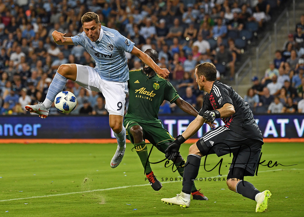 Sporting KC midfielder Krisztian Nemeth (9) attempts a shot on goal during the second half against Portland Timbers goalkeeper Jeff Attinella (1) at Children's Mercy Park.