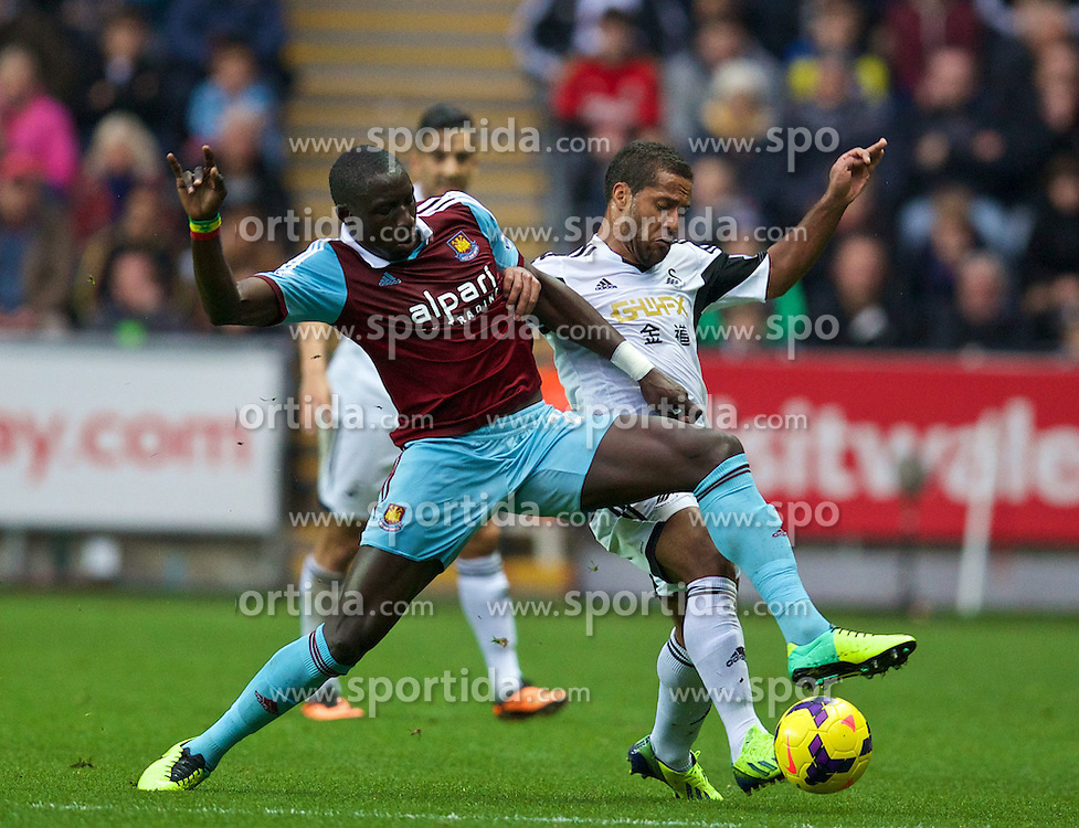 27.10.2013, Liberty Stadion, Swansea, ENG, Premier League, Swansea City vs West Ham United, 09. Runde, im Bild Swansea City's Wayne Routledge, action against West Ham United's Mohamed Diame // during the English Premier League 09th round match between Swansea City AFC and West Ham United at the Liberty Stadion in Swansea, Great Britain on 2013/10/27. EXPA Pictures &copy; 2013, PhotoCredit: EXPA/ Propagandaphoto/ David Rawcliffe<br /> <br /> *****ATTENTION - OUT of ENG, GBR*****