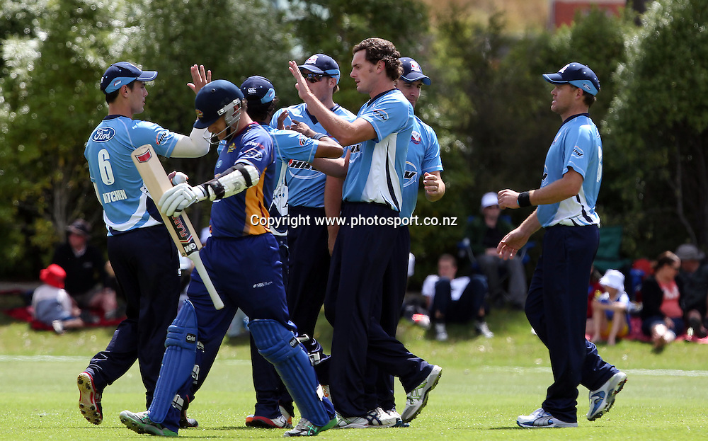 Kyle Mills celebrates the wicket of Nathan McCullum.<br /> Twenty20 Cricket - HRV Cup, Otago Volts v Auckland Aces, 15 January 2012, University Oval, Dunedin, New Zealand.<br /> Photo: Rob Jefferies / photosport.co.nz