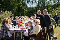 """Approximately 130 guests joined together at the table for Sunday morning's """"Breakfast in the Orchard"""" at Smith Orchard in Belmont served by Chef Halligan of Local Eatery and his crew.    (Karen Bobotas/for the Laconia Daily Sun)"""