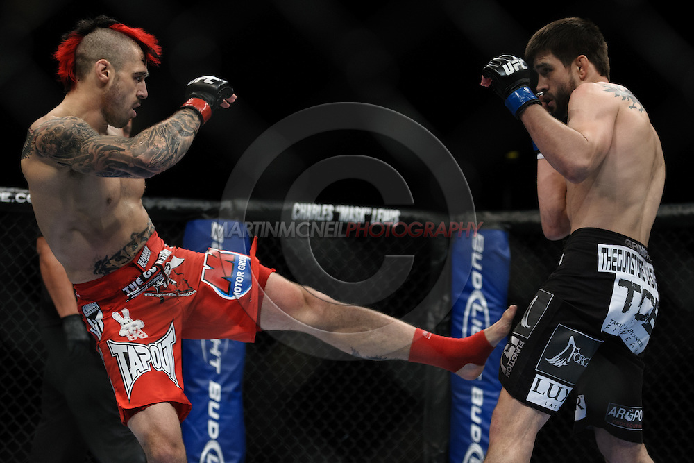 "LONDON, ENGLAND, OCTOBER 2010: Dan Hardy (left) finds his range against Carlos Condit during ""UFC 120: Bisping vs. Akiyama"" inside the O2 Arena in Greenwich, London"