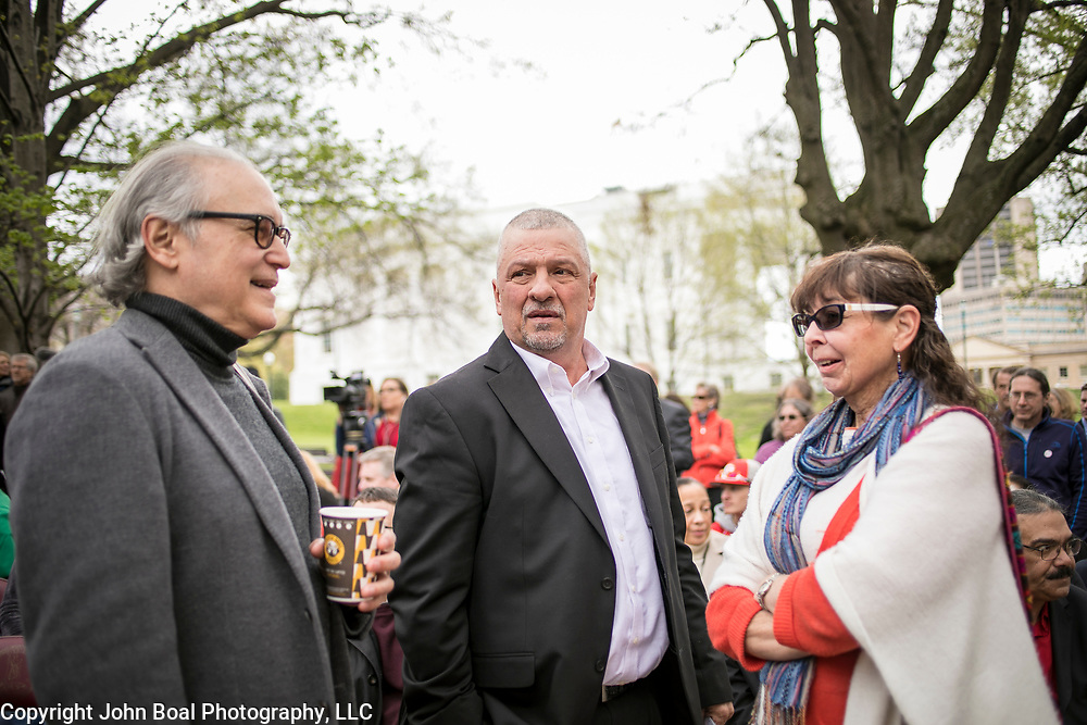 Alan Michelson, Mohawk member of Six Nations of the Grand River, speaks with Monacan Chief, Dean Branham and Karenne Wood, Monacan, prior to the dedication ceremony for Mantle: Virginia Indian Tribute, a monument designed on Virginia State Capitol Square, in Richmond, Virginia, on Tuesday, April 17, 2018. Michelson, an artist based in New York, designed the monument.  John Boal Photography