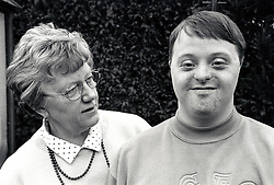Young man with Down's Syndrome with his mother UK 1995 MR