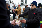 Rob Narciso, right, lights a candle during the community dedication of a grove of trees at the Salt Lake City cemetery in remembrance of victims of the Newtown, Conn. shootings, Thursday, Dec. 27, 2012.