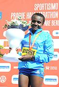 Joyciline Jepkosgei (KEN) poses after winning the women's race in the Prague Half Marathon in a world record 1:04:52 in the Prague, Czech Republic on Saturday, April 17, 2017. Jepkosgei set four world records along with the 10K (30:05), 15K (45:37) and 20K (1:01:25). (Jiro Mochizuki/IOS)