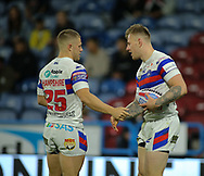 Tom Johnstone of Wakefield Trinity celerbrates scoring the try with team mate Ryan Hampshire against Huddersfield Giants during the Betfred Super League Super 8's match at the John Smiths Stadium, Huddersfield<br /> Picture by Stephen Gaunt/Focus Images Ltd +447904 833202<br /> 31/08/2018