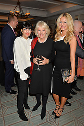 Left to right, CLAUDIA WINKLEMAN, the DUCHESS OF CORNWALL and TESS DALY at a party hosted by Ewan Venters CEO of Fortnum & Mason to celebrate the launch of The Cook Book by Tom Parker Bowles held at Fortnum & Mason, 181 Piccadilly, London on 18th October 2016.