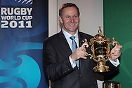 Prime Minister John Key with the Webb Ellis Cup during the One Year To Go Media Session. Countdown to the 2011 RWC, Eden Park, Auckland, Thursday 9 September 2010. Photo: Andrew Cornaga/PHOTOSPORT