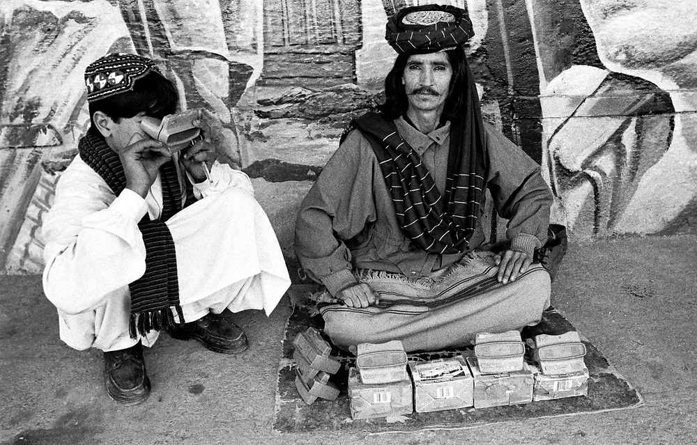 Fakir with the magic of 3D vision Cinema Road  Old City  Peshawer Pakistan January 2002....©David Dare Parker/AsiaWorks Photography