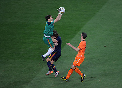 Iker CASILLAS collides with his team mate  Carles PUYOL as  Robin VAN PERSIE looks on during the 2010 FIFA World Cup South Africa  Final match between Holland and Spain at Soccer City  on 11 July, 2010 in Johannesburg, South Africa.