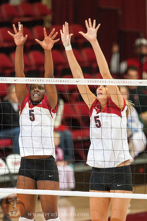 November 25, 2006; Stanford, CA, USA; Stanford Cardinal outside hitter Nji Nnamani (5, left) and middle blocker Michelle Mellard (15, right) during the game against the Washington State Cougars at Maples Pavilion. The Cardinal defeated the Cougars 30-27, 30-23, 30-18.