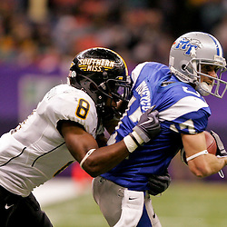 Dec 20, 2009; New Orleans, LA, USA; Middle Tennessee State Blue Raiders wide receiver Patrick Honeycutt (17) is tackled by Southern Miss Golden Eagles defensive back Justin Wilson (8) during the first half of the 2009 New Orleans Bowl at the Louisiana Superdome.  Mandatory Credit: Derick E. Hingle-US PRESSWIRE