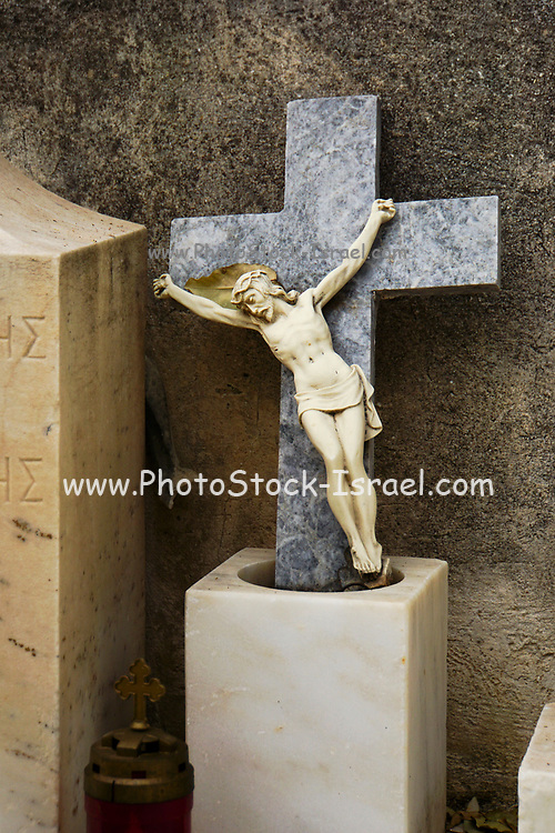 Crucifix in a graveyard in Athens, Greece