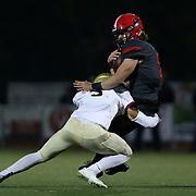 November 06, 2015; Oregon City, OR, USA; CONNOR MITCHELL (5) is tackled on a run.  Oregon City hosted Southridge at Pioneer Stadium.  Photo by David Blair
