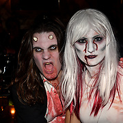 People dresses up Zombie continue party at Waxy O'Connor's fund raising for Shelter from the Storm - London's only free homeless shelter  in World Zombie Day: London 2018 - TEXT BRNZ57 £3 TO 70070 TO DONATE or read on for more ways to contribute. 6 October 2018.