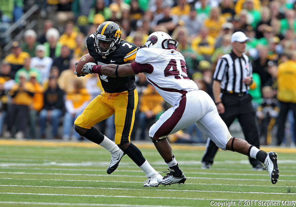 September 24, 2011: Iowa Hawkeyes wide receiver Marvin McNutt (7) tries hold off Louisiana Monroe Warhawks linebacker DaCorris Ford (45) during the fourth quarter of the game between the Iowa Hawkeyes and the Louisiana Monroe Warhawks at Kinnick Stadium in Iowa City, Iowa on Saturday, September 24, 2011. Iowa defeated Louisiana Monroe 45-17.