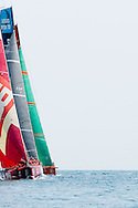 Camper, Telefonica and Groupama sailing to windward during ProAm races at the 2011-2012 Volvo Ocean Race Miami.