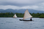 A man sailing between the San Blas Islands in Panama