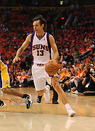 May 23, 2010; Phoenix, AZ, USA; Phoenix Suns guard Steve Nash (13) handles the ball during the first quarter in game three of the western conference finals in the 2010 NBA Playoffs at US Airways Center.  The Suns defeated the Lakers 118-109.   Mandatory Credit: Jennifer Stewart-US PRESSWIRE