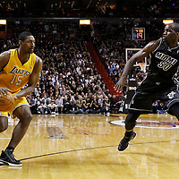 19 January 2012: Miami Heat center Joel Anthony (50) defends on Los Angeles Lakers small forward Metta World Peace (15) during the Miami Heat 98-87 victory over the Los Angeles Lakers at the AmericanAirlines Arena, Miami, Florida, USA.