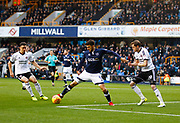 Millwall's Lee Gregory tangles with Sheffield United's Enda Stevens (L) and Richard Stearman during the EFL Sky Bet Championship match between Millwall and Sheffield Utd at The Den, London, England on 2 December 2017. Photo by John Marsh.