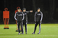 Swansea Manager Garry Monk (right) during Swansea city FC team training in Landore, Swansea, South Wales on Wed 19th Feb 2014. the team are training ahead of tomorrow's UEFA Europa league match against Napoli.<br /> pic by Phil Rees, Andrew Orchard sports photography.