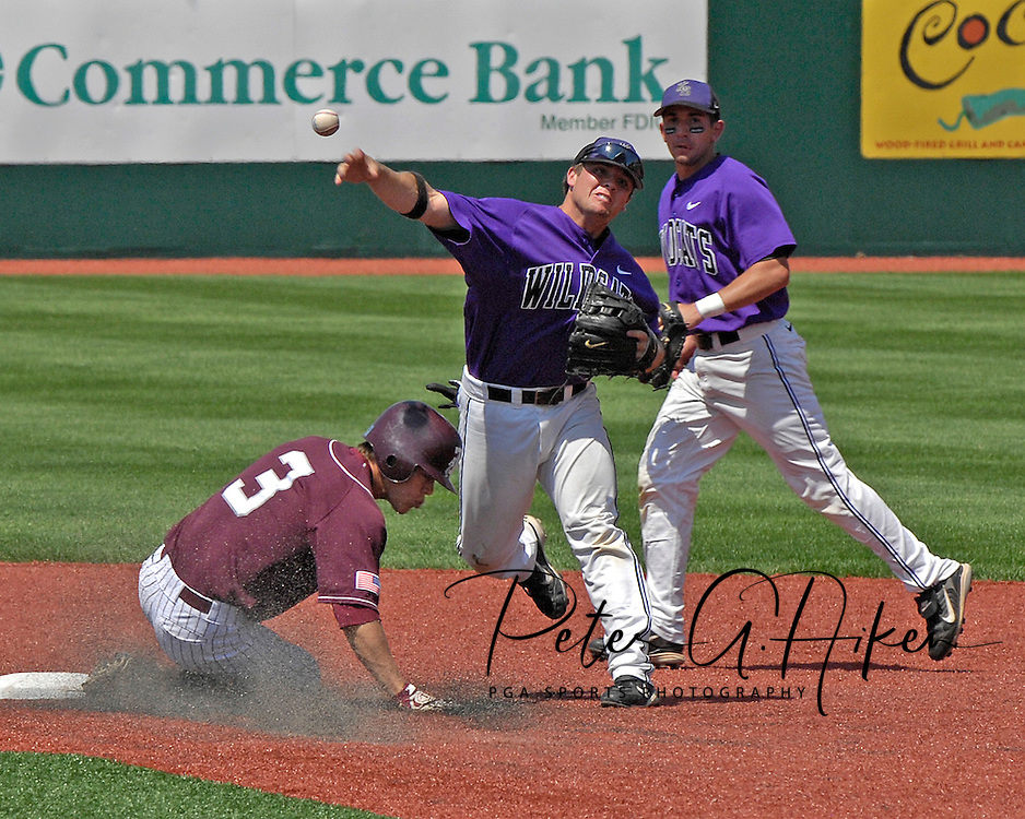 Kansas State shortstop Eli Rumler (R) throws to first base after forcing out Texas A&M's Blake Stouffer (3) in the fifth inning at Tointon Stadium in  Manhattan, Kansas, May 13, 2007.  K-State defeated the 11th ranked Aggies 11-6.