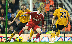 LIVERPOOL, ENGLAND - Saturday, December 26, 2009: Liverpool's Fernando Torres and Wolverhampton Wanderers' Jody Craddock during the Premiership match at Anfield. (Photo by: David Rawcliffe/Propaganda)