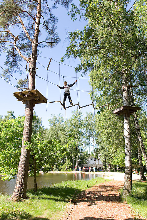 Boy Climbing on Exercising Trail at Adventure Park, Tallinn, Estonia