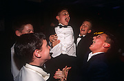The friends of a young 13 year-old Jewish boy help celebrate his coming-of-age at his bar bar mitzvah party, on 12th February 2001, in London, England.