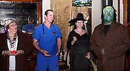 """Jerry Francis (right) and audience members begin a costume contest during Mayhem & Mystery's production of """"Costume Carousing"""" at the Spaghetti Warehouse in downtown Dayton, Monday, September 12, 2011."""