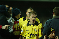 Photo: Aidan Ellis.<br /> Doncaster Rovers v Aston Villa. Carling Cup. 29/11/2005.<br /> Villa's Steven Davis trudges off at the end surrounded by Jubilant Doncaster fans