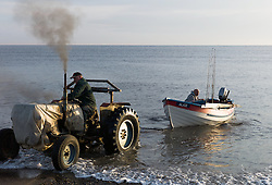 © Licensed to London News Pictures. 16/05/2014<br /> <br /> Saltburn by the Sea, England<br /> <br /> Fishermen launch their boat from the beach at Saltburn in Cleveland before heading out to sea for the morning.<br /> <br /> Photo credit : Ian Forsyth/LNP