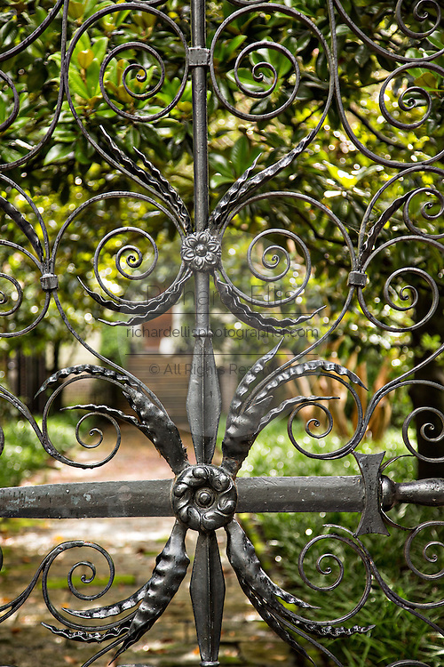 A detail of the Sword Gate on Legare Street in Charleston, SC.
