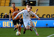 Charlie Taylor is fouled during the Sky Bet Championship match between Wolverhampton Wanderers and Leeds United at Molineux, Wolverhampton, England on 6 April 2015. Photo by Alan Franklin.