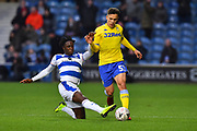 Kun Temenuzhkov (57) of Leeds United is tackled by Osman Kakay (24) of Queens Park Rangers during the The FA Cup 3rd round match between Queens Park Rangers and Leeds United at the Loftus Road Stadium, London, England on 6 January 2019.