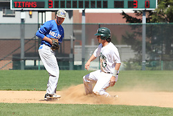 11 April 2015:  infielder Kaleb Krigbaum tags 2nd base as Gino Cavalieri slides in during an NCAA division 3 College Conference of Illinois and Wisconsin (CCIW) Pay in Baseball game during the Conference Championship series between the Millikin Big Blue and the Illinois Wesleyan Titans at Jack Horenberger Stadium, Bloomington IL