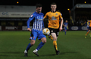 Scott Wharton of Cambridge United and Padraig Amond of Hartlepool United in action during the EFL Sky Bet League 2 match between Cambridge United and Hartlepool United at the Cambs Glass Stadium, Cambridge, England on 14 March 2017. Photo by Harry Hubbard.