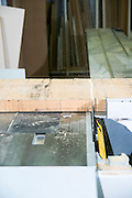 carpenter uses a power saw to cut oak wood