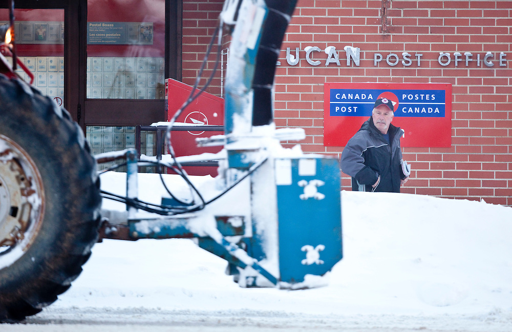 A man leaves the post office in Lucan, Ontario December 8, 2010. The small community north of London bore the brunt of snow squalls with over a metre falling since Sunday.<br /> The Canadian Press/GEOFF ROBINS