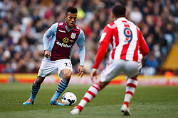 Aston Villa Defender Ryan Bertrand (ENG) is challenged by Stoke Forward Peter Odemwingie (NGA) - Photo mandatory by-line: Rogan Thomson/JMP - 07966 386802 - 23/03/2014 - SPORT - FOOTBALL - Villa Park, Birmingham - Aston Villa v Stoke City - Barclays Premier League.