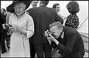 Bill Cunningham photographing at a party on a boat for Helen Hayes. New York. 27 June 1990. <br /> SUPPLIED FOR ONE-TIME USE ONLY> DO NOT ARCHIVE. © Copyright Photograph by Dafydd Jones 248 Clapham Rd.  London SW90PZ Tel 020 7820 0771 www.dafjones.com