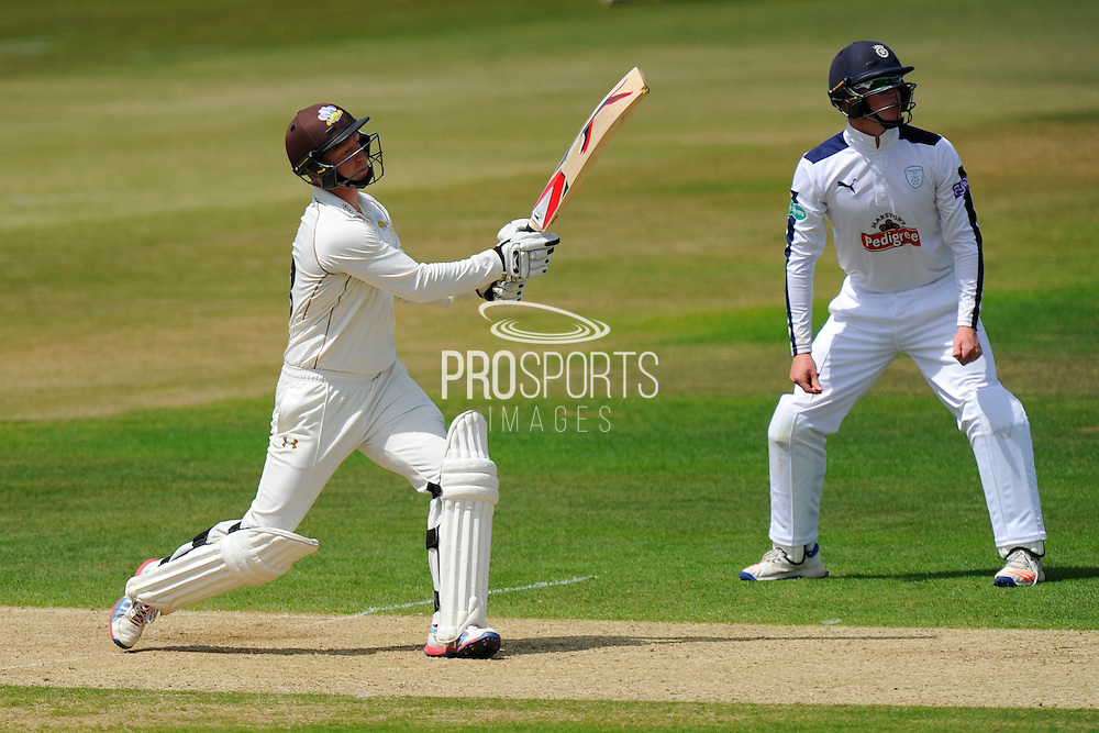 Surrey's Gareth Batty watches the ball fly over the boundary for six during the Specsavers County Champ Div 1 match between Hampshire County Cricket Club and Surrey County Cricket Club at the Ageas Bowl, Southampton, United Kingdom on 18 July 2016. Photo by Graham Hunt.