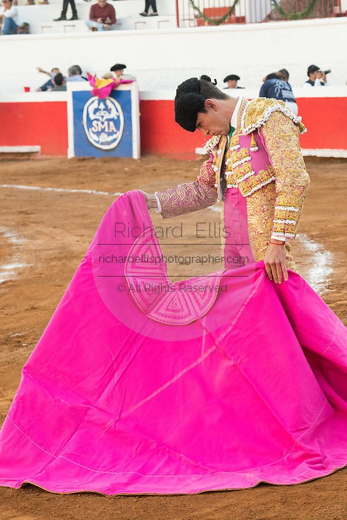Mexican Bullfighter Arturo Macías drapes the cape to attract a bull during a bullfight at the Plaza de Toros March 4, 2018 in San Miguel de Allende, Mexico.