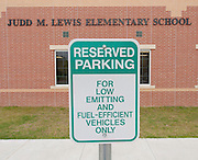 Lewis Elementary School has reserved parking for eco-friendly vehicles.