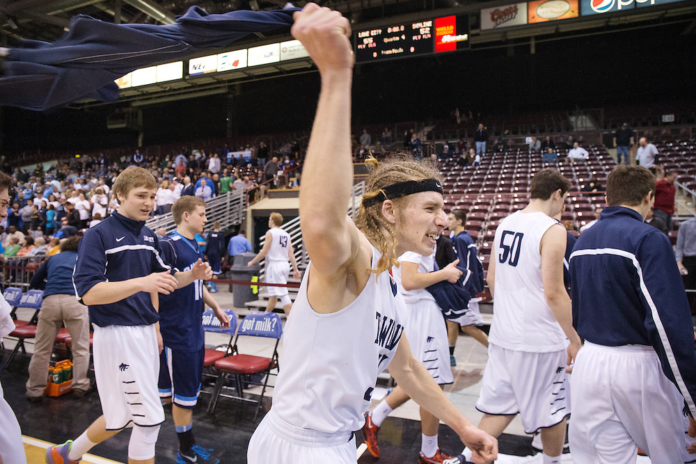 GABE GREEN/Press<br /> <br /> Lake City&rsquo;s Jacob Dahl waves a shirt over his head in celebration after the team won their first game in the 2014 Real Dairy Shootout Thursday against Skyview.