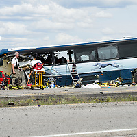 A shoe lays near the road on 1-40. A semi-tractor trailer that was traveling on the eastbound lane crossed over into westbound lane, resulting in a collision with a Greyhound bus traveling to Los Angeles, CA. The incident occurred in Thoreau, NM Thursday afternoon. The accident killed at least seven people, according to New Mexico State Police.