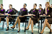 ABU DHABI, UAE - FEBRUARY 8, 2015: A group of young women are intently watching safety exercises, as part of the cabin crew training.