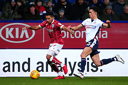 Korey Smith of Bristol City goes past Antonee Robinson of Bolton Wanderers - Mandatory by-line: Robbie Stephenson/JMP - 02/02/2018 - FOOTBALL - Macron Stadium - Bolton, England - Bolton Wanderers v Bristol City - Sky Bet Championship